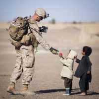 US soldier and kids